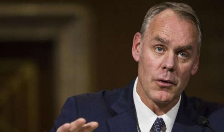Ryan Zinke sitting at an official hearing.