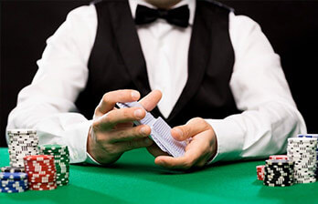 Live Casino Dealer Holding Cards
