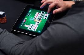 Arcade Games - Man Playing Card Game on Tablet